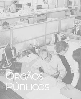 Imagem de um escritório com pessoas trabalhando em suas mesas